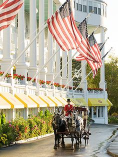 Mackinac Island, Michigan. Cars are banned in this little town so the mode of transportation is usually horses and carriages! So cute. =)