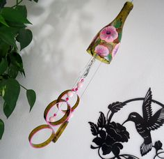 Wine bottle windchime,  Amber wind chime, Pink flowers, yard art, patio decor, recycled bottle wind chime, hand painted chime by LindasYardArt on Etsy