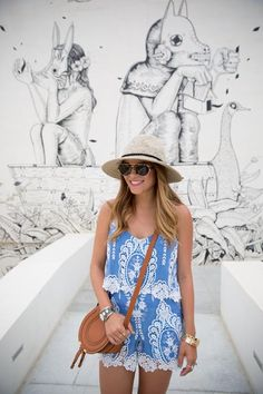 This beautiful blue romper paired with a panama hat makes it the perfect outfit for a hot summers day! #CatchSummer #ad