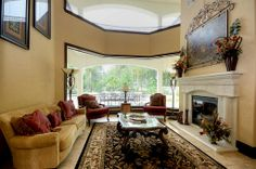 view from front door, butted glass - two story ceiling, invites you into the home