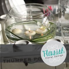 Simple, inexpensive centerpiece by Fleurish Floral Design | Fish Bowl, Bear Grass, Floating Candles