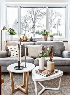 If you are lucky enough to have large windows with a striking view, bring those natural shades inside your living room to merge the outside with the inside, thereby increasing the space and creating an elegant natural ambiance.
