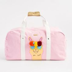 This large pink duffle bag is perfect to fill with all your travel  essentials. Decorated b396723d2d23