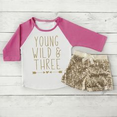 Birthday Girl Outfit. Raglan Shirt and Gold Sequin Shorts. The perfect way to add some sparkle to your little one's special day. We at Bump and Beyond Designs love to help you celebrate life's preciou