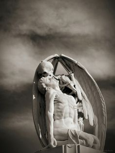 Sculpture in Barcelona's Poblenou Cemetery.  The Kiss of Death (El Petó de la Mort in Catalan and El beso de la muerte in Spanish) dates back to 1930. It is attributed to Jaume Barba but it seems quite likely that it was created by Joan Fontbernat. Santi MB via Flickr.