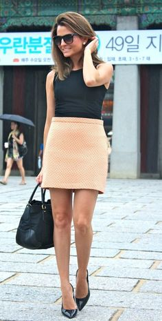 This nude color skirt is beautiful paired with a simple black top and of course a gorgeous bag.
