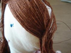 Part how to sew girls hair : pigtails I want to show you how I make doll's hair out of knitting yarn. First you need to draw a line on your doll's head, starting from her forehead al… Knitted Doll Patterns, Doll Sewing Patterns, Knitted Dolls, Yarn Dolls, Fabric Dolls, Doll Wigs, Doll Hair, Loose Hairstyles, Girl Hairstyles