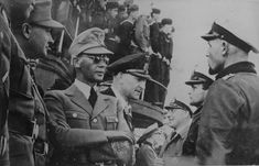 """Narvik, Norway, July 15, 1942: German submariners, just returned from """"wolf-packing"""" an allied convoy in the northern waters, converse with Norway's Reichskommisar Josef Terboven (with sunglasses) and Norway's Nazi collaborator PM Vidkun Quisling (on Terboven's right). Narvik offered an excellent harbor for German U-boats patrolling the North Atlantic, although it did not offer the level of protection against air attack as the French coast bases."""