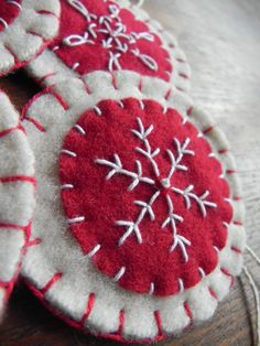 This is a good idea, and would work in a variety of colors: Felt snowflake ornament with embroidery.