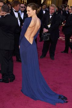 Hilary Swank caused quite a stir as she twirled around on the red carpet in her seemingly conservative dress to reveal a daringly low back. The navy Guy Laroche gown skimmed over her figure and was the perfect ensemble to pick up the award for Best Actress at the 2005 Academy Awards.