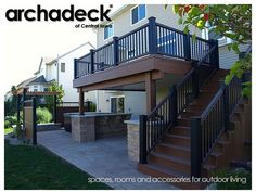 TimberTech Earthwoods Evolutions decking (Pacific Walnut) with Black and Walnut Radiance Rail on this Johnston deck north of Des Moines. Under the deck, a Belgard Urbana and Mega Arbel patio housing a private hot tub area. Decks, Patios, Porches and