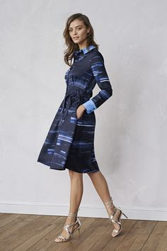 A brushstroke print and belted silhouette make for an easy-to-wear dress. This navy long-sleeved shirtdress is polished and chic, making for a great office wear look | Banana Republic