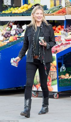 Picking up some supplies: Kate Moss emerged from a corner shop in Camden, North London wit...