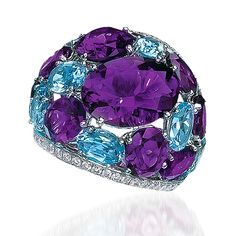Cellini Aurora Collection Ring Amethyst & Blue Topaz Dome Ring; Oval-shaped amethysts and blue topaz are bordered by rows of round brilliant diamonds, in 18-karat white gold. Diamond weight: approximately 1.27 carats total; Amethyst weight: approximately 13.23 carats total; Blue Topaz weight: approximately 2.82 carats total.