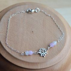 Items similar to Sterling Silver Lotus Bracelet, Silver Lotus with Moonstone and Pink Jade, Dainty Delicate Lotus Bracelet with Gemstones, Tiny Lotus Charm on Etsy Gemstone Bracelets, Silver Bracelets, Jewelry Accessories, Unique Jewelry, Roxy, Lotus, Beaded Necklace, Charmed, Gemstones