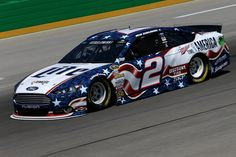 Brad Keselowski, driver of the #2 Miller Lite Ford, during practice for the NASCAR Sprint Cup Series Quaker State 400 presented by Advance Auto Parts at Kentucky Speedway on June 27, 2014 in Sparta, Kentucky.