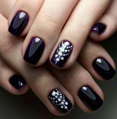 This is rather simple variant of nail art, but you can feel yourself elegant and stylish with it. Use usual black gel nail polish for it. You should varnish your nails evenly. The covering on the nails should be ideally smooth. Then make the accent on the ring nail – you can paint several dots arc…