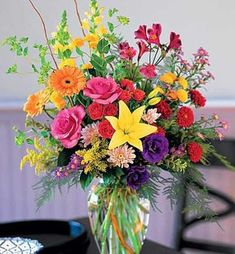 The Dazzler is a beautiful floral arrangement featuring red, yellow, and purple flowers. Call or click your local Wayne, New Jersey florist, Bosland's Flower Shop. Bright Flowers, Fake Flowers, Summer Flowers, Purple Flowers, Beautiful Flowers, Bright Pink, Bright Colors, Flowers In A Vase, Easter Flowers