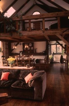 Barn house..love this! This is the way I want my living area and dining area set up along with the loft upstairs. Cute cabin idea.