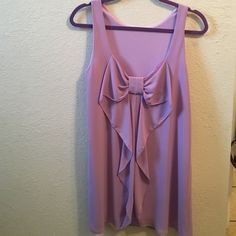 Everly Lilac Dress Lilac. Low back with bow. Fits loosely. Never worn & in great condition. Size small, fits sizes 0-4. 100% polyester. Everly Dresses Midi
