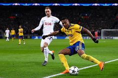 Alex Sandro of Juventus competes for the ball with Christian Eriksen of Tottenham Hotspur during the UEFA Champions League Round of 16 Second Leg match between Tottenham Hotspur and Juventus at Wembley Stadium on March 7, 2018 in London, United Kingdom. - 75 of 110