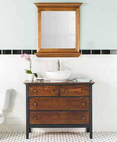 Small Bathroom Vanity With Sink For Your Home A rustic dresser transforms into a stylish bathroom vanity with the addition of a modern, round vessel sink. Brushed nickel accessories, a soft blue wall, and timeless white and black tile complete the look. Dresser Vanity Bathroom, Bathroom Vanity Designs, Rustic Bathroom Vanities, Rustic Bathrooms, Vanity Sink, White Bathroom, Bathroom Ideas, Bathroom Sinks, Bathroom Cabinets