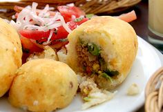 Papa Rellena is a croquette filled with spicy beef, onions and tomatoes, and wrapped in mashed potatoes that are formed around the mixture. Peruvian Cuisine, Peruvian Recipes, I Love Food, Good Food, Yummy Food, Yummy Recipes, Bolivian Food, Bolivian Recipes, Colombian Cuisine