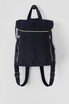 The Madeline Zipper Backpack is perfect for a day time outing at the park or lake! The backpack features small front zipper pockets, inner lined pockets, interior zipper pocket, back pocket with a snap button closure and a double zipper closure. The stylish bag features a subtle snakeskin print.