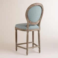 A Clic With Round Back Silhouette Our Blue Linen Paige Counter Stool Is Crafted