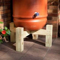 DIY this for the rain barrel. Especially like the platform on this one.