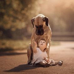 A few years ago, some of Seliverstoff's friends asked him to take photos of their daughter Alice in a park. They had their Great Dane, Sean, with them, so they decided to incorporate him into the photos. After seeing the results, Seliverstoff knew he was onto something special. | You'll Never See Anything As Adorable As These Little Kids With Big Dogs