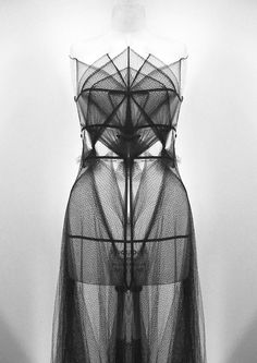 Lea Peckre for JP Gaultier | Tumblr: again, there's the shades of grey, the intentional veiling and unveiling, and as an added bonus, it looks like a spider's web. Perfect for Linnea.