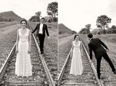 bride and groom on train tracks | round barn farm wedding in red wing minnesota | photo: Studio 306