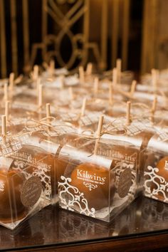 These adorable candy apple wedding favors are one of our WeddingWire editors' top picks. WeddingWire has tons of wedding favor recommendations at all price points. Click for more wedding favor ideas. Planning your wedding has never been so easy (or fun!)! WeddingWire has tons of wedding ideas, advice, wedding themes, inspiration, wedding photos and more. {Sarah Bradshaw Photography}