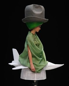 I'm not sure what's happening in this photo by Walter Van Beirendonck.  Cowgirl, muppet plane woman?