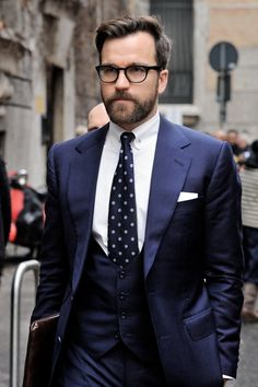 Navy Blue Suit, Pindown collar, waistcoat, glasses, hair and all. Maybe ditch the waistcoat.