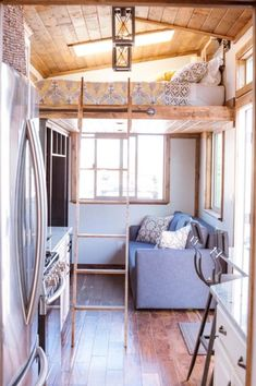 This tiny house has on the main floor and of loft space split between a queen bedroom loft with skylight and a guest loft. Between the two lofts and pull out couch this tiny house can sleep up to six people. Tiny House Listings, Tiny House Plans, Tiny House On Wheels, Tiny Spaces, Loft Spaces, Living Spaces, Living Room, Living Area, Home Design