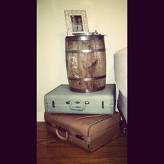 My nightstand I made! 2 antique suitcases a old whiskey bin and a mirror on top!
