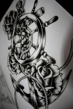 Anchor and rose tattoo