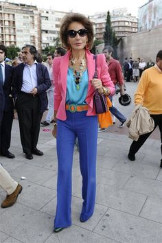 Great multicolored street style look on Nati Abascal: deep periwinkle blue slacks, light blue top, deep pink jacket, and orange belt. Older Women Fashion, Sexy Older Women, Womens Fashion, Fashion Over, Paris Fashion, Fashion Looks, Fashion Hats, Fashion Spring, Fashion Ideas