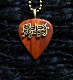 Dark wooden Gold musical guitar pick pendent