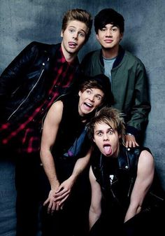 Love this picture so much<<< everyone looks rather punk rock then there's Ashton my beautiful unicorn being adorable