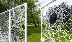 Lace Garden surrounded by a lace chain link fence, Located in Amsterdam, The Netherlands,