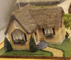 English Cottage dollhouse in 1:48 scale, exhibited by Faye Liner at the Spring 2012 Seattle Dollhouse Miniature Show