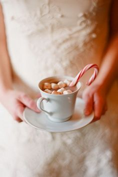Peppermint flavored hot chocolate with mini marshmallows and a candy cane sticking out the mug! Delicous!