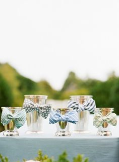 These mint julep glasses with bow ties would make a cute vase or could even stand alone.
