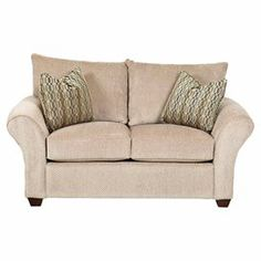 """Add a classic touch to your living room or home library with this timeless loveseat, showcasing welt tailoring and rolled arms.  Product: LoveseatConstruction Material: Fabric and woodColor: BeigeFeatures:  Accent pillows included22"""" Seat heightWelt tailoringRolled armsDimensions: 32"""" H x 73"""" W x 38"""" D"""