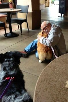A corgi bringing joy to an elderly man she just met. | 50 Animal Pictures You Need To See Before You Die