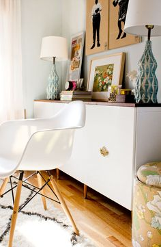 Fauxdenza with some simple mid-century furniture legs (found at Ace Hardware). Ikea cabinet bases with gloss white doors + vintage hardware on doors + fancy walnut wood top. via Very Sarie