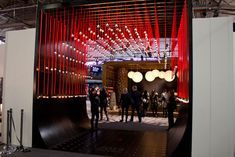 Tunnel of exposed lightbulbs hung overhead at Architectural Digest Home Show. Photo: Nadia Chaudhury/BizBash